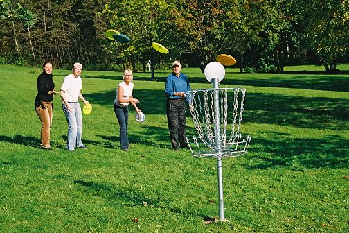 Group playing disc golf